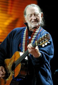 Willie Nelson performing at Farm Aid 2006 at the Tweeter